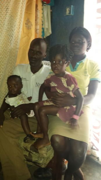 Lillian, her husband with their two children.