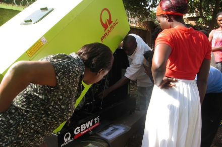 Ladies being showed on how to operate a generator