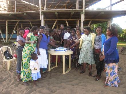 Women cutting cake